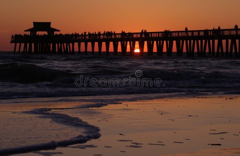 Sunset naples pier stock images