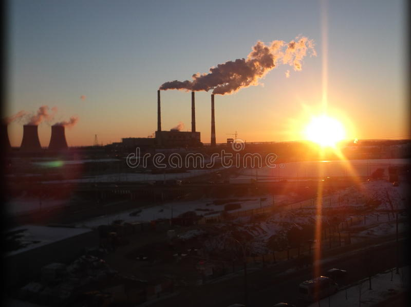 Sunset near the power plant. royalty free stock photo