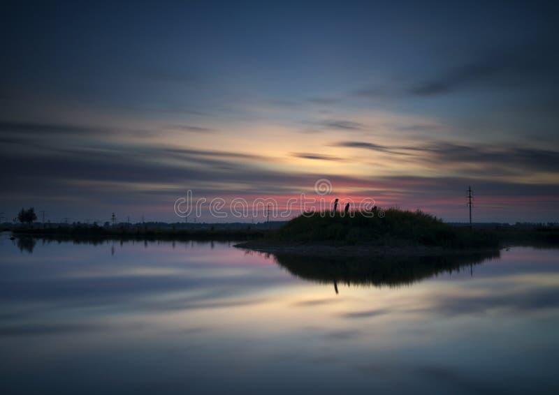 Sunset near Sliedrecht. Nice sunset above a small lake with an island near the Dutch village Sliedrecht royalty free stock photos