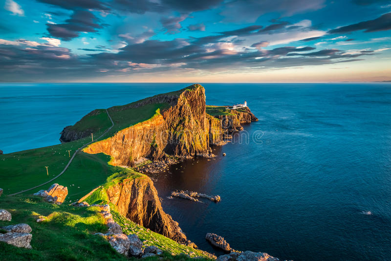 Sunset at the Neist point lighthouse, Scotland royalty free stock images
