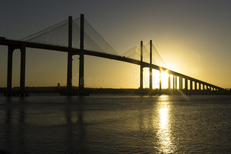 Sunset -Newton Navarro Bridge, Natal, RN, Brazil. The Newton Navarro Bridge, is one of the biggest cable-stayed bridges in Brazil. It is located in the city of stock photography