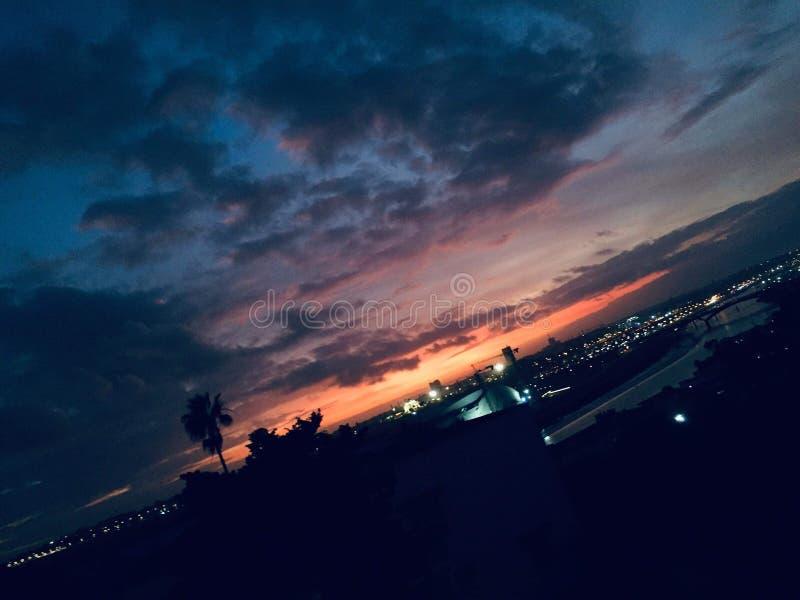 Sunset night  sky burning  city stock photo
