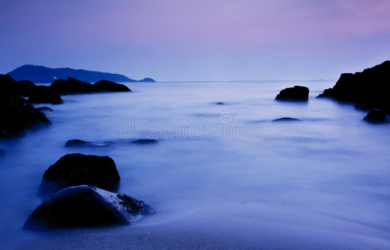 Sunset And Night View Of Rock Stock Photos