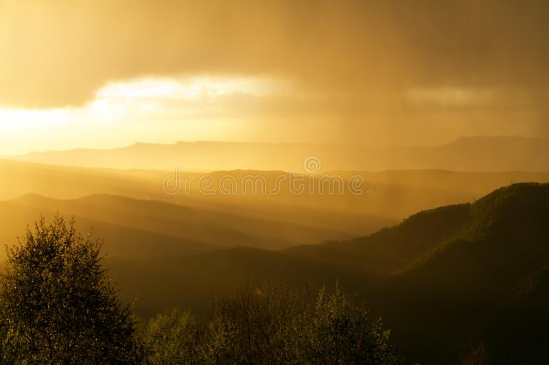 Sunset and North Caucasus mountain stock image