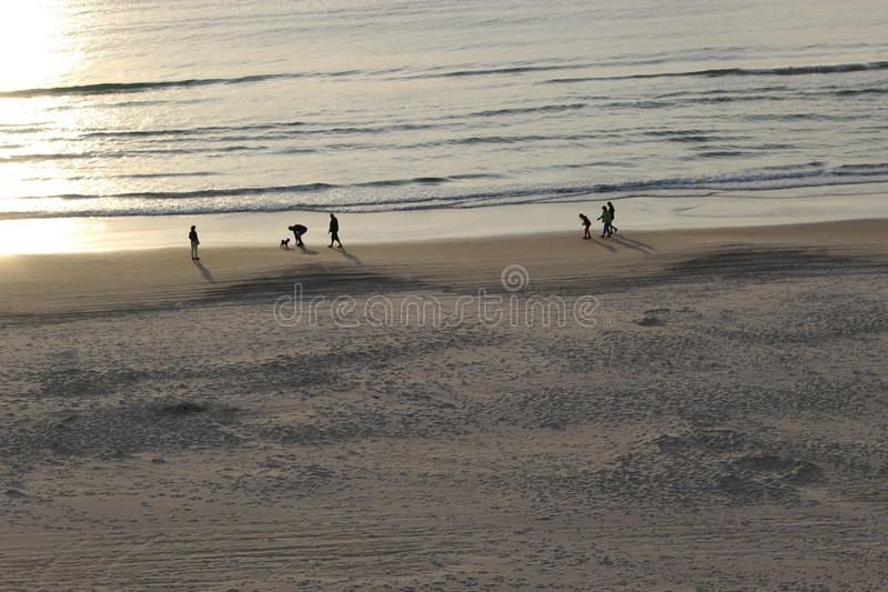 Sunset at the North sea. People are walking on the beach of Lokken in Denmark, Scandinavia, Europe stock images
