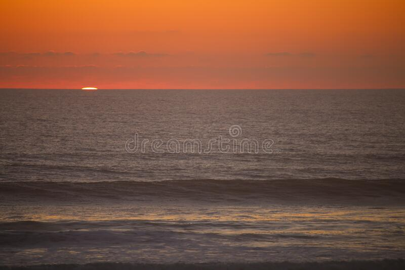 Sunset on the ocean with beautiful clouds. And red sky stock images