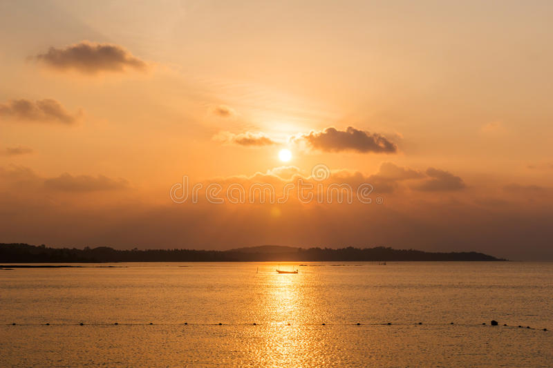 Sunset on the ocean. With boat royalty free stock photo