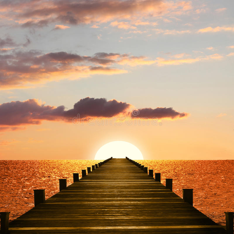 Free Sunset Ocean Scenery With Wooden Boardwalk Royalty Free Stock Photo - 67113105