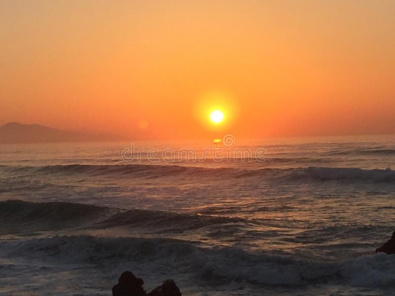 Sunset on the ocean royalty free stock photo