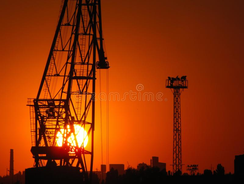 Sunset in Odessa, Ukraine. Construction cranes at sunset in the port of Odessa, Black Sea, Ukraine stock photos