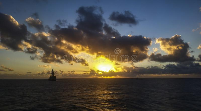 Sunset in the offshore area, drilling ship in an offshore day. MORE OPTIONS IN MY PORTFOLIO stock images