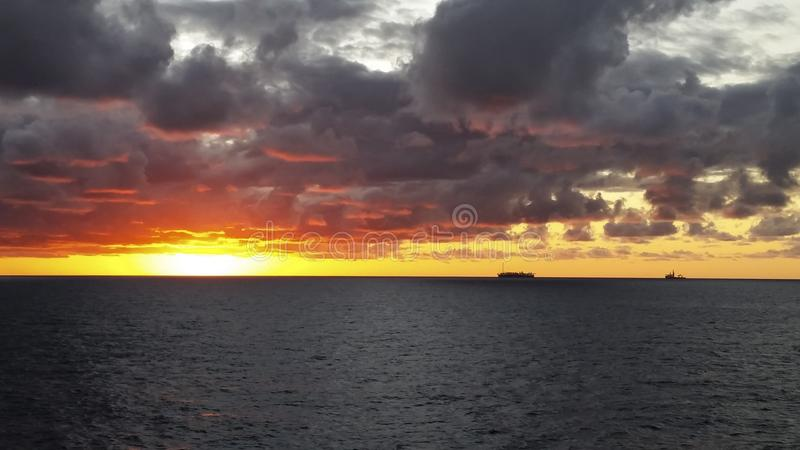 Sunset in the offshore area, FPSO and other vessels together in an offshore day. MORE OPTIONS IN MY PORTFOLIO royalty free stock photo
