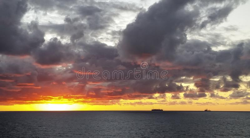 Sunset in the offshore area, FPSO and other vessels together in an offshore day. MORE OPTIONS IN MY PORTFOLIO stock image