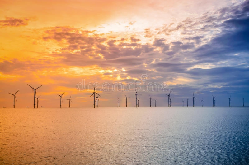 Sunset Offshore Wind Turbine in a Wind farm under construction of England coast royalty free stock image