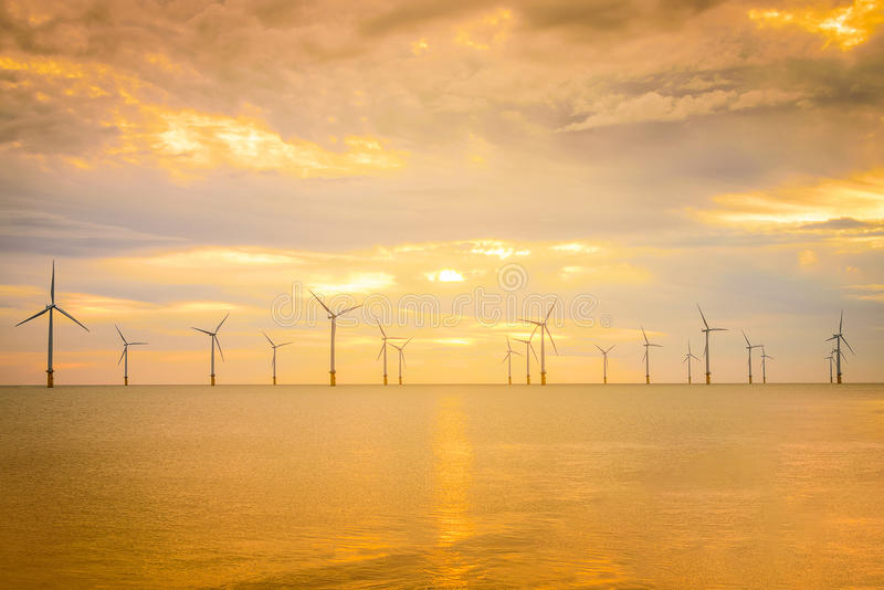 Sunset Offshore Wind Turbine in a Wind farm under construction o stock photos