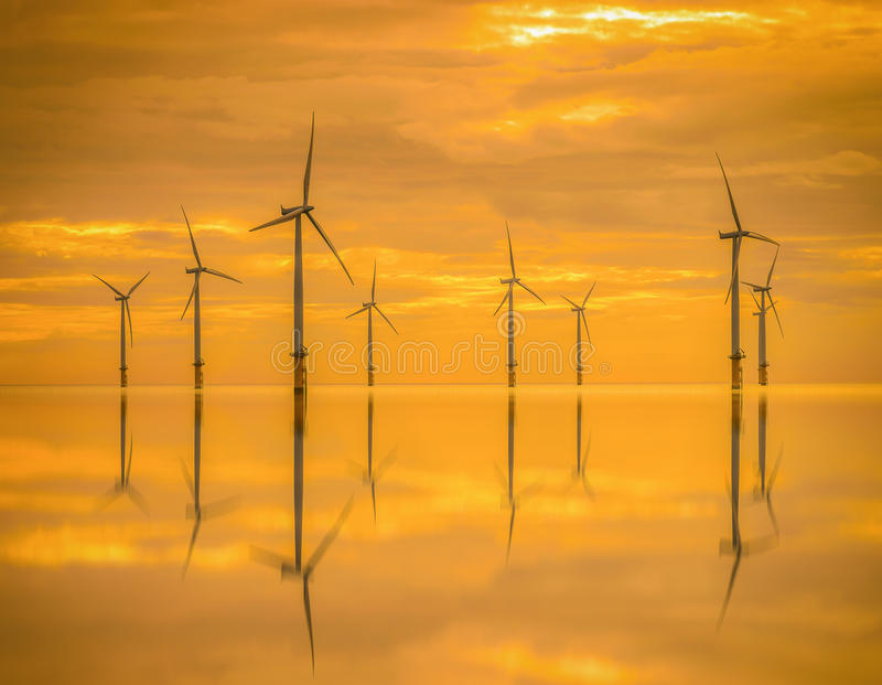 Sunset Offshore Wind Turbine in a Wind farm under construction royalty free stock photos