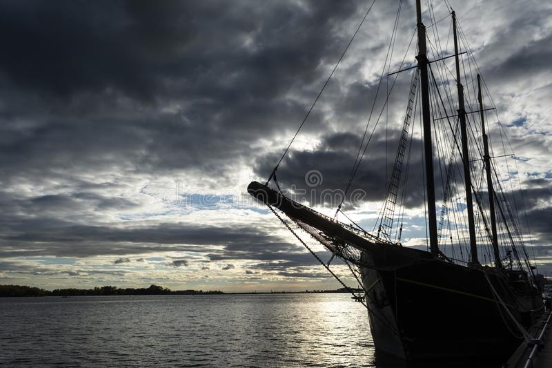 Sunset at the Ontario lake with tall ship standing at marina royalty free stock image