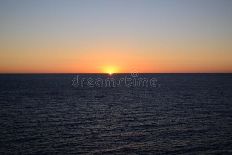 Sunset in open sea royalty free stock photo