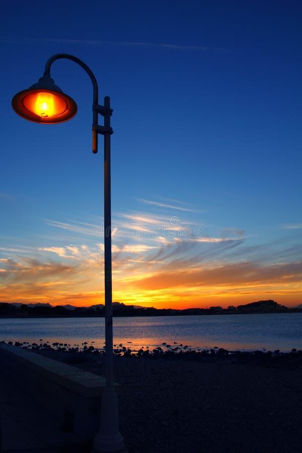 Download Sunset Orange Blue Seascape Light Lamppost Stock Image - Image: 16586569