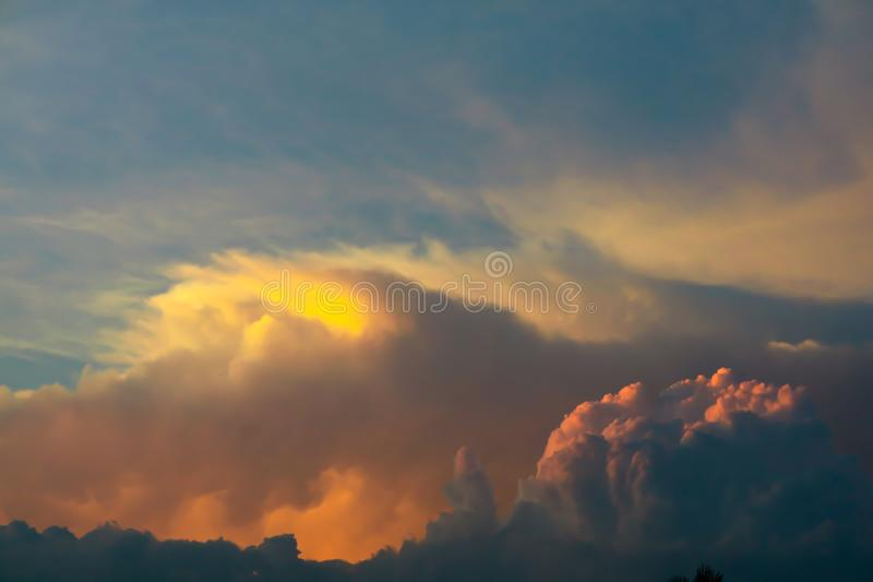 sunset orange cloud sunshine in dark sky soft cloud stock photography
