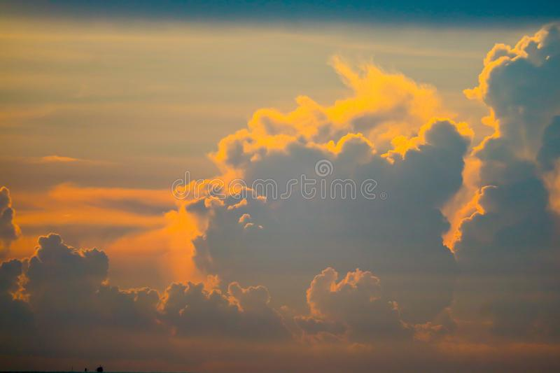 Sunset orange heap cloud back on dark silhouette sky and flame cloud. Background abstract beauty blue boat bright cloudscape colorful dramatic dusk evening royalty free stock image