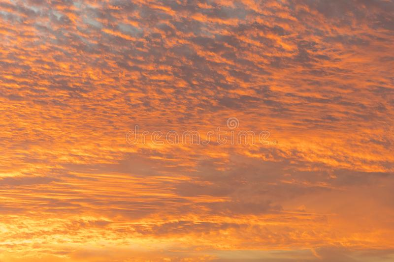 sunset with orange sky. Hot bright vibrant orange and yellow colors sunset sky. sunset with clouds stock image