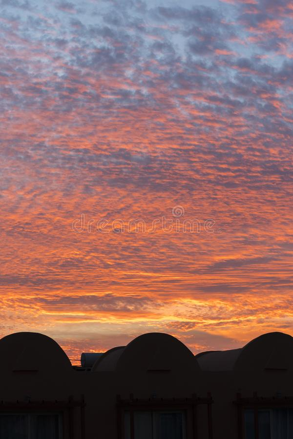 sunset with orange sky. Hot bright vibrant orange and yellow colors sunset sky. sunset with clouds. vertical photo stock photo