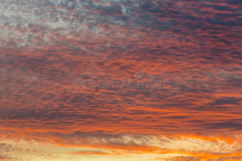 sunset with orange sky. Hot bright vibrant orange and yellow colors sunset sky. sunset with clouds stock photos