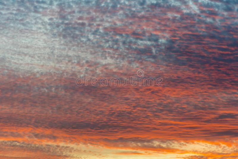 Sunset with orange sky. Hot bright vibrant orange and yellow colors sunset sky. sunset with clouds.  royalty free stock photography