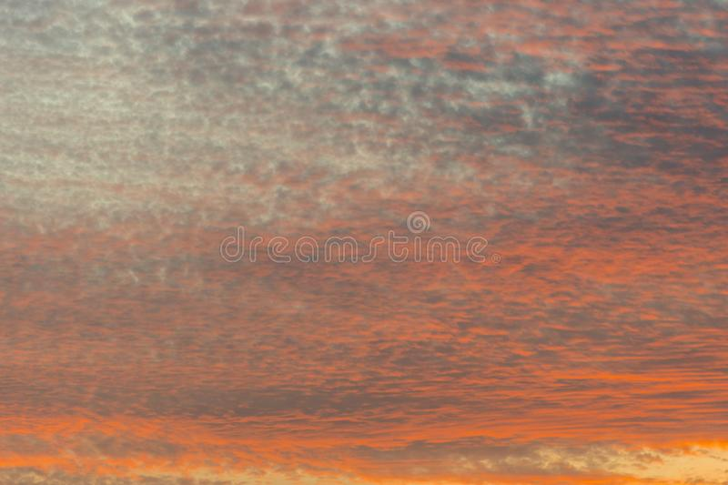 sunset with orange sky. Hot bright vibrant orange and yellow colors sunset sky. sunset with clouds royalty free stock images