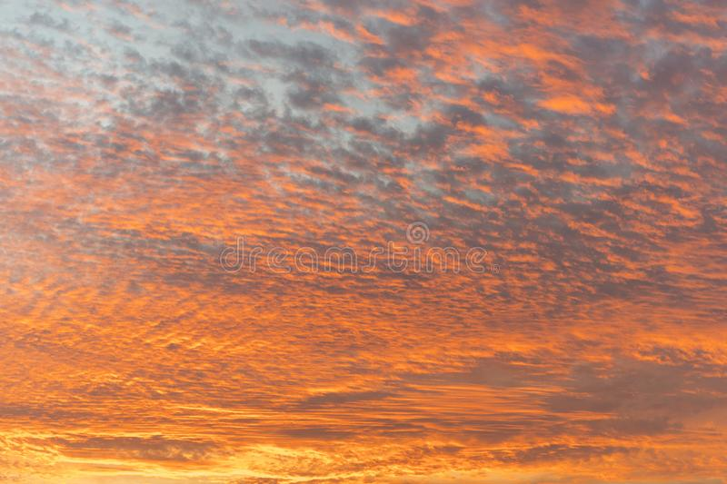 Sunset with orange sky. Hot bright vibrant orange and yellow colors sunset sky. sunset with clouds.  stock image