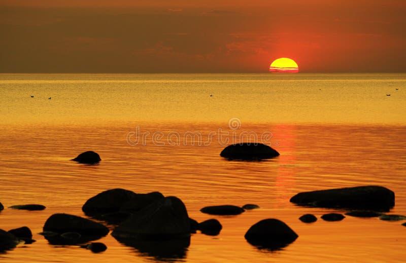 Sunset and orange sky over baltic sea stock image