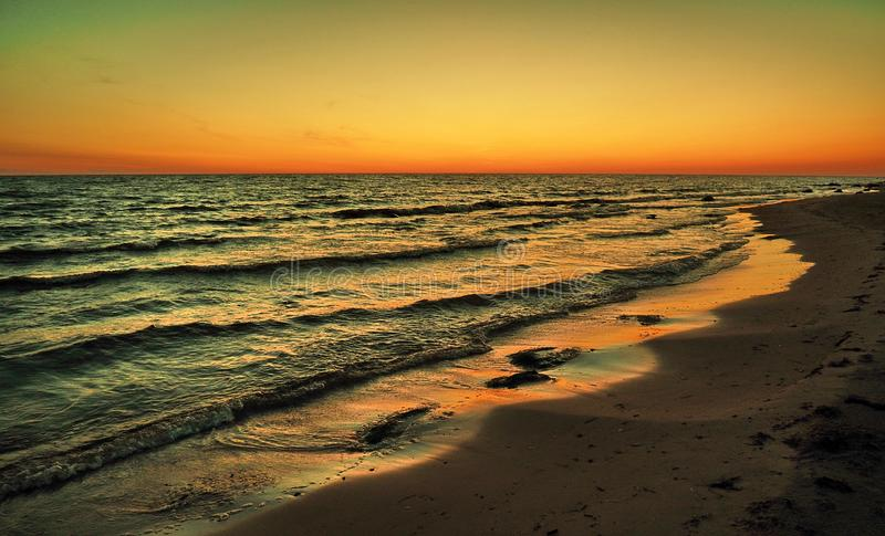 Sunset and orange sky over baltic sea stock photography