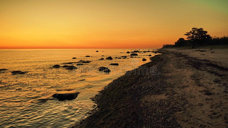 Sunset and orange sky over baltic sea royalty free stock photography