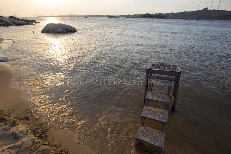 Sunset on the Orinoco River and the beach, Ciudad Bolivar, Venez. Sunset on the Orinoco River and the beach which is the place to cross the river by boat. The stock photos