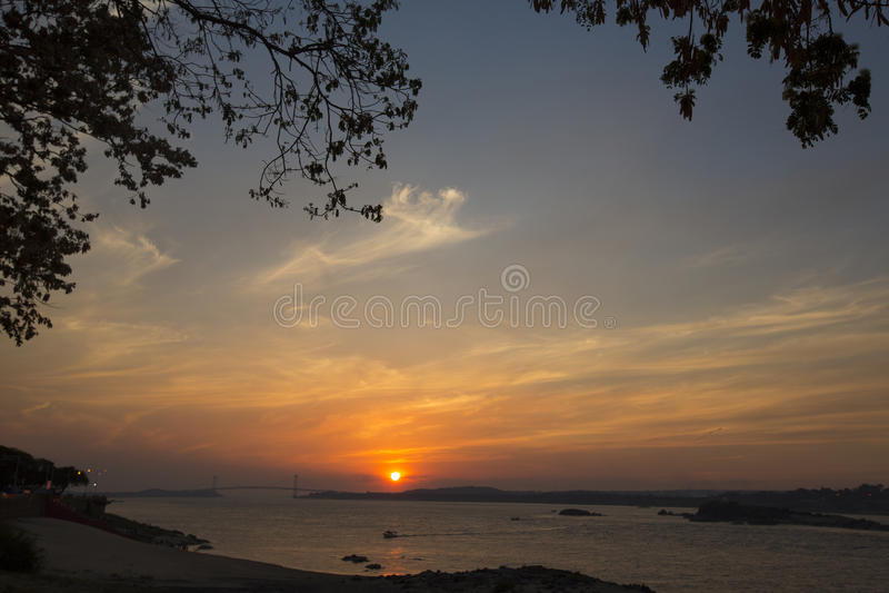 Sunset on the Orinoco River, Ciudad Bolivar, Venezuela. Sunset on the Orinoco River with the suspended bridge in Ciudad Bolivar. Venezuela 2015 stock photography