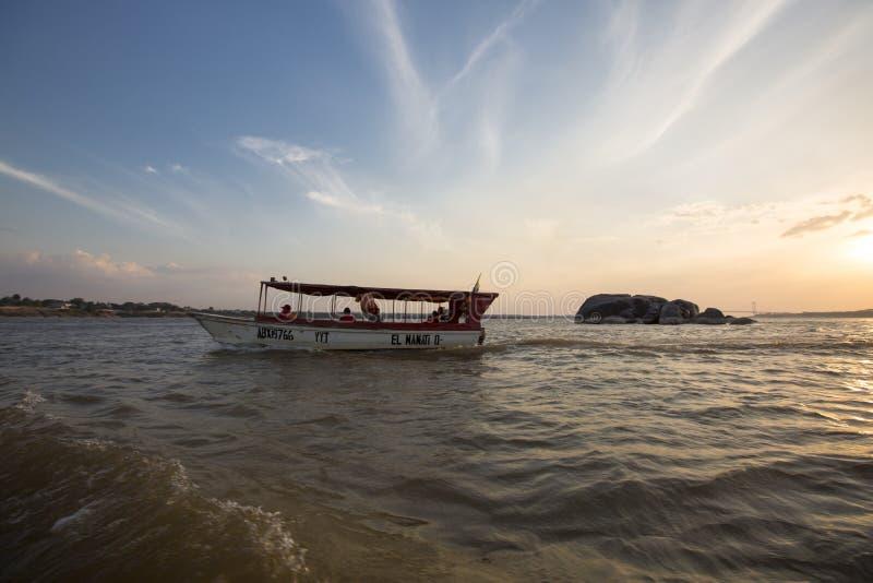 Sunset on the Orinoco River with passenger boat. Ciudad Bolivar,. CIUDAD BOLIVAR, VENEZUELA, APRIL 9: Sunset on the Orinoco River with a small passenger boat royalty free stock photo
