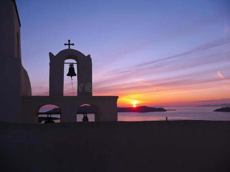 Sunset through the Orthodox church bell tower on Santorini royalty free stock photo
