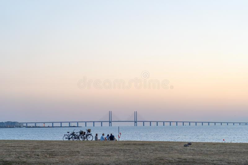 Sunset over Öresundsbron. With friends in Malmö, Sweden during summer royalty free stock photography