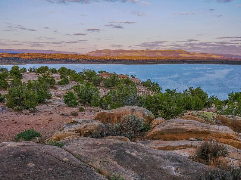 Sunset over Abiquiu Lake in Northern New Mexico. View of Abiquiu Lake and the mountains in northern New Mexico as seen from above the campground royalty free stock image