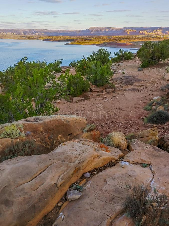 Sunset over Abiquiu Lake in Northern New Mexico. View of Abiquiu Lake and the mountains in northern New Mexico as seen from above the campground stock images