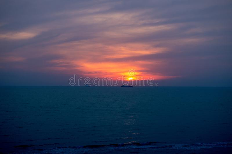 Sunset over Adriatic sea, Durres, Albania. Scenic sunset over Adriatic sea, Durres, Albania. Ferry passing by the horizon under the sun stock photos