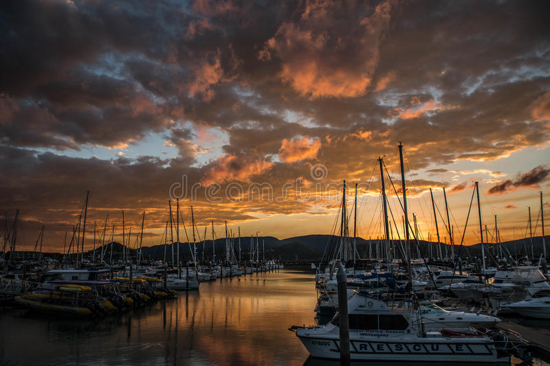 Sunset over Airlie Beach marina. After a day sailing the Whitsundays. Queensland, Australia royalty free stock photography