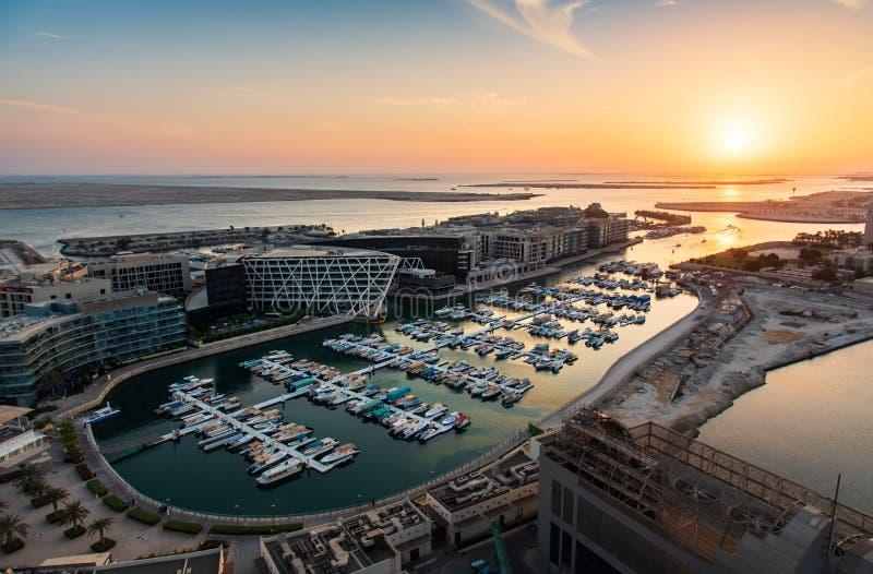 Sunset over Al Marasy Marina view with luxury yachts in Abu Dhabi, Al Bateen area royalty free stock photos