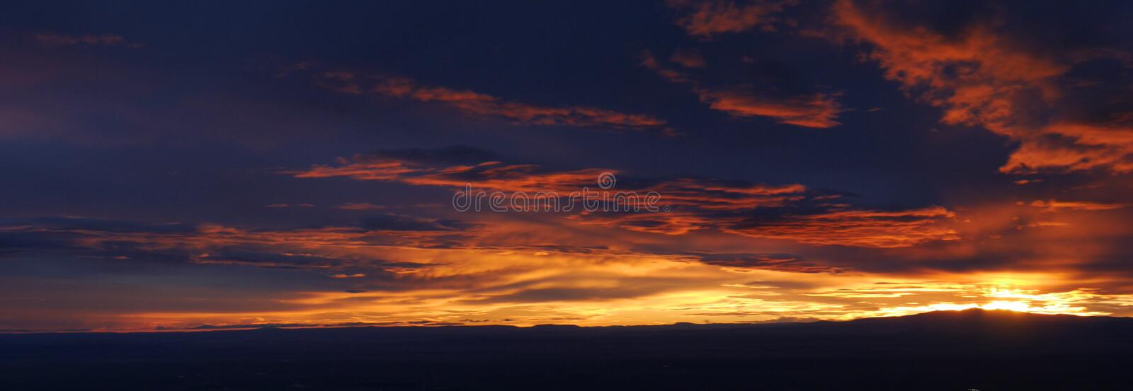Sunset over Albuquerque. Spectacular sunset from the top of Sandia Peak in the Mountain abover Albuquerque New Mexico royalty free stock photography