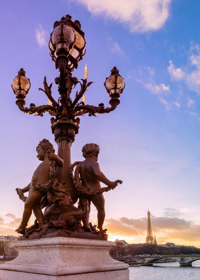 Sunset over the Alexandre III bridge. Sunset over the lanterns of the Pont Alexandre III with the Eiffel Tower in the background royalty free stock photos