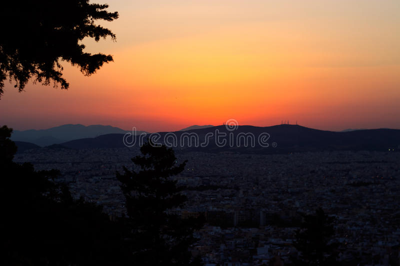 Sunset over Athens hills stock image