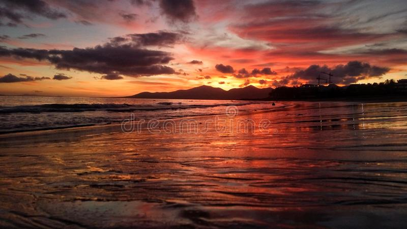 Beautiful bright red sunset over the atlantic ocean in puerto del carmen on lanzarote canary island in spain royalty free stock photos