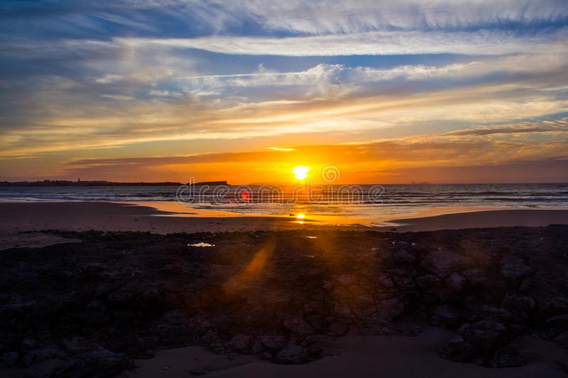 Sunset over the Atlantic ocean watched from Baleal beach, Portugal stock photography