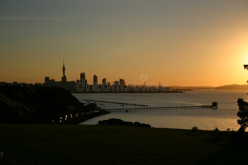 Sunset over Auckland Harbour royalty free stock image